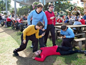 Seems like Kirk, Spock, McCoy, and Scotty have already lost Ensign Ricky. Guess they're in a very dangerous situation. Then again, why these guys are at a Renaissance Festival is beyond me.