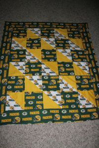 Now this quilt is guaranteed to protect you from the cold as well as passionate Green Bay Packers fans. Yes, they can be a rowdy bunch if you let them.