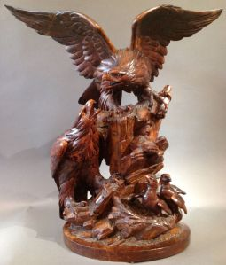 Birds are a popular motif in wood sculpture. And you'll see a lot. However, how I see it, I think the dad is the one taking care of the chicks while the mom is spreading her wings. Because in bald eagles, the female is supposed to be bigger.