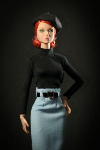 Now this might not be a Barbie. And I'm definitely sure she's not supposed to be a French gangster's moll. However, her outfit and facial expression suggests that she's straight from a French gangster movie.