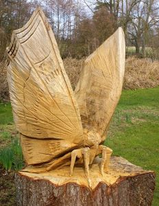 Man, those wings look huge. And I bet they weren't easy to carve with a chainsaw. Still, big bugs are terrifying. Need I say more?