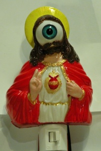 On second thought, I'll take my chances in the dark without this. Seriously, this is the creepiest night light I've ever seen. I mean Jesus's face is just a large eyeball. Why?