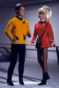In this Ken is Captain Kirk, one of the most alien STD laden men in the galaxy. Barbie is Yeoman Rand, Kirk's main squeeze who strangely disappeared after the first season.