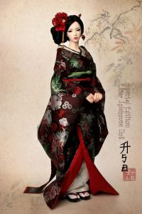 I can tell this is a Japanese doll since she's wearing a kimono or two. However, I do love the red flower in her hair. This might be a foreign doll, by the way.