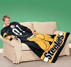 Now I'm sure the NFL sells team snuggies all the time. But this one is particularly noteworthy since it has a player from the neck down on it.
