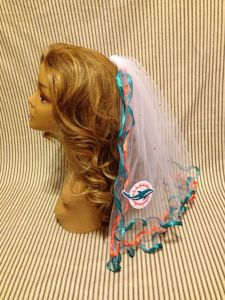 Now I have no idea why any girl would want a NFL themed bachelorette party. And even so, I'm not sure who the hell would have a veil like this.