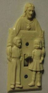 Then again, maybe a Jesus light switch isn't a good idea. I mean look at its placement for God's sake. Doesn't help that he has his arms around the children.
