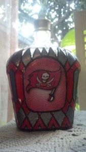 Yes, it looks like a stained glass bottle used to store alcoholic drinks. But still, pirates love their rum. And besides, it's hand painted.