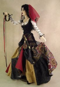 I've seen quite a few gypsy fashion dolls. But I think this one is especially lovely, especially the dress.
