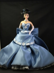 Now they have a lot of holiday Barbies out there. However, this one with the dark hair, blue snowflake dress, and cameo pearl necklace is the one I liked best.