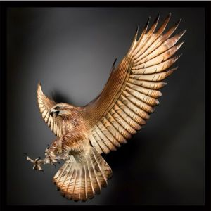 Hard to believe that this hawk sculpture looks so lifelike. Seems like there's nothing to keep it held up. Love the feathers, too.