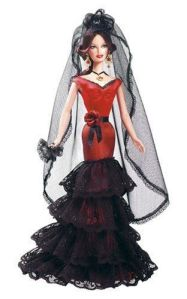 Now I don't think she's a flamenco dancer since she lacks castanets. However, I love her beautiful black lace on her red dress, fan and veil.