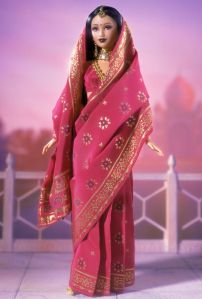 I know this isn't bridal attire since Indian women typically wear bright red and a lot more jewelry. And I'm sure this isn't really Barbie either. But I'll take it.