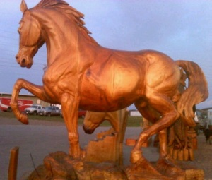 Horses are another common motif in wood sculpture. And this one is no exception. However, if you want to buy a wooden horse as big as this, always check for Greeks.