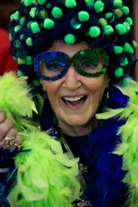 Yes, this granny has to wear her blue wig with green, her feather boas, and her sparkly frames. And now she's ready for showtime.