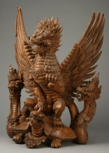 As you can see, this is an Asian carving. Probably from China or Japan. Not sure how old it is. But somehow it seems East Asian dragons tend to have scales and feathers.