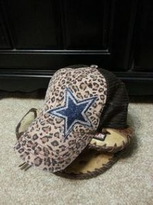 Now an NFL licensed baseball hat is one thing. But one with a sparkly logo and leopard prints? That's just insane. Seriously, that's the tackiest baseball hat I've ever seen.