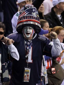 Yeah, I know the hat's a bit absurd. But at least this guy isn't wearing a Tom Brady jersey. Of course, he might bump into a door way on his way out.