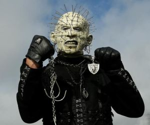 While Hellraiser may look like a slasher horror movie villain, he's actually an Oakland Raiders fan. And he just dresses that way to support his team. He's really nothing to worry about.