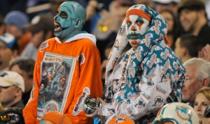 I don't know about you. But if I was at a Miami Dolphins game, I'd stay the hell away from these two scary clowns. Because to be honest, they're terrifying the hell out of me.