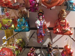 Yes, these are Buddhist ornaments. And yes, Christmas is a Christian holiday. But then again, Christmas is a popular holiday so anything goes.