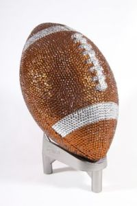 Now there are things that should and can be bedazzled. And there are things that shouldn't be bedazzled. A football would generally fall into the latter.