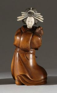 This piece might be of some Japanese art form which I don't know the name of. But while most of her body is wood, her head consists of ivory and metal. Also, another old medieval piece you can't buy.