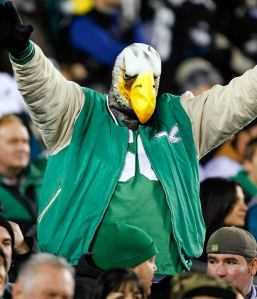 And yes, that guy's wearing an eagle head for the game. And yes, despite the gestures, he doesn't seem to carry on facial expressions too well.