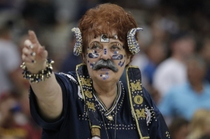 "I don't know what's more disturbing. The ram horns or the fact she has a mustache as well as ""Mom"" on her chest. Also, the stars on her face don't help either."