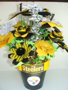 The flowers and foliage are fake. But I'm sure people would buy this anyway. Because I know that Steeler fans kind of have a reputation for being crazy.