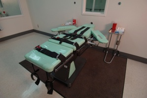 No, this isn't a bed from Christian Grey's sex dungeon. This is a bed they use to restrain a prisoner for lethal injection, the most popular method and