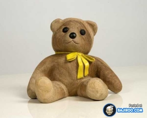 Yes, it may look cute but it's not cuddly. Besides, since it's a wood carving, trying to hug it might cause splinters.