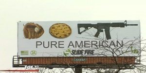 This is a billboard in Illinois that highlights the convoluted ideas of American cultural heritage. One of these is an assault rifle which is a weapon of choice among mass shooters. This is appalling.