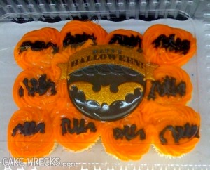 Those are bats? Seriously, they just look black scribbles on orange icing.