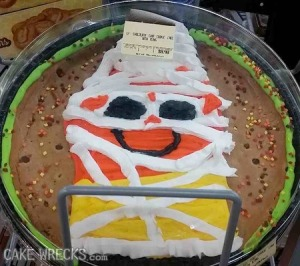 Oh, my God. For one, nobody likes candy corn, let alone with a smiley face. Second, it's even more stupid that it's made to look like a mummy.