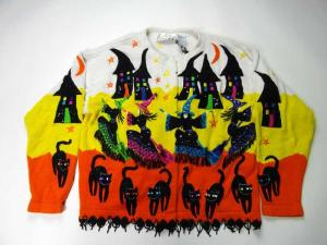 As if the dancing witches, houses and black cats can't make this cardigan tacky enough. It also has to be in candy corn colors. Kind of disgusting.