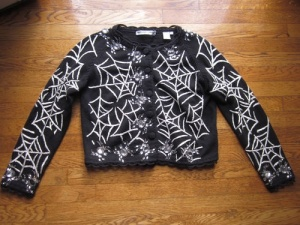 If you go clubbing or to a rave, this might be the kind of sweater you'd want to go with on Halloween. Of course, this one is tacky as hell.