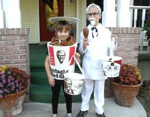 Boy is Colonel Sanders while the girl is a bucket of coronary inducing fried chicken with 11 herbs and spices. Like how they're using KFC buckets for trick or treating.