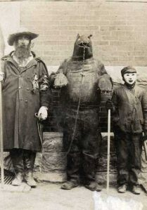 Now we wouldn't have a group costume like that today, just because we don't chain up bears anymore. Still, the bear is quite terrifying and so is the kid.