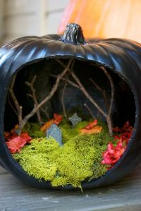 Now this one uses twigs for bare trees as well as moss for the graveyard ground. Not sure if the leaves are real.