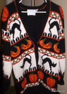 You can tell this is a Halloween sweater because it has black cats on it. If it didn't have black cats, it might as well be a Thanksgiving sweater.