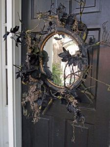 And this old mirror definitely looks like it's been in the garage for far too long. Then again, it also has black leaves on it, too. Yes, it was made like that on purpose.