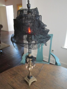 Now that's a spooky lamp with black cob webs galore. Of course, it's a much more tasteful decoration than black lighting.