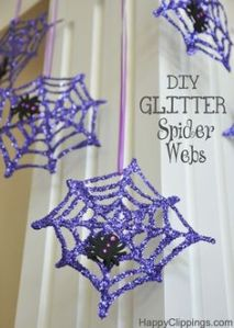 Yes, purple and glittery spider webs with spiders on them. And they're held by ribbon, too.