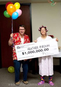 Look about as what you'd expect from stereotypical winners of Publishers Clearinghouse sweepstakes. He's in a tacky Hawaiian shirt and she's in her nightgown and curlers.