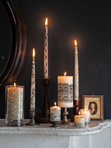Why didn't I think about using black lace with candles? This looks awesome. Still, hope burning lace doesn't pose a dangerous fire hazard.