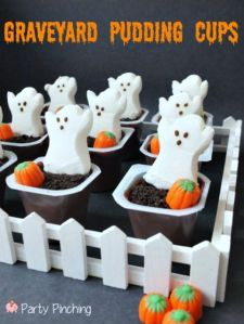 The ghosts are of the sugary marshmallow stuff associated with peeps. The pumpkins are candy corn. But I'm sure the chocolate pudding is edible and tasty, too.