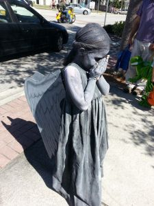 Now you've seen statues like this in cemeteries. But have you seen a child dressed like one? I think not.