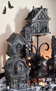 Well, painting black craft cottages is easy enough to make haunted houses. Yes, black makes things creepy, indeed.