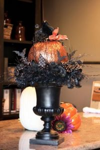 Now this pumpkin is so shiny, especially with the black bird and ribbon on top. Still, I really like the urn and the other decorations on it. So stunning and scary.